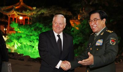 U.S. Secretary of Defense Robert M. Gates (left) and Gen. Xu Caihou, vice chairman of China's Central Military Commission, meet at the Diaoyutai Guest House in Beijing on Monday, Jan. 10, 2011. (AP Photo/Larry Downing, Pool)