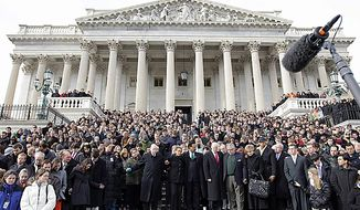 Members of Congress and staff members observe a moment of silence for Rep. Gabrielle Giffords, Arizona Democrat, and other victims of Saturday's shooting rampage, on Monday, Jan. 10, 2011, on the east steps of the U.S. Capitol in Washington. At center are Delegate Eleanor Holmes Norton, D.C. Democrat, and Rep. Emanuel Cleaver II, Missouri Democrat. (AP Photo/Charles Dharapak)