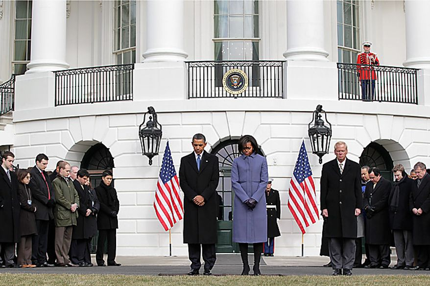 President Barack Obama and first lady Michelle Obama are joined by government employees on the South Lawn of the White House in Washington, Monday, Jan. 10, 2011, to observe a moment of silence for Rep. Gabrielle Giffords, D-Ariz., and the other victims of an assassination attempt against her.  (AP Photo/J. Scott Applewhite)