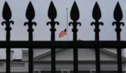 As ordered by President Obama, the American flag flies at half-staff over the White House at dawn, in Washington, Monday. Jan. 10, 2011, in observance of Rep. Gabrielle Giffords, Arizona Democrat, and the other victims of an assassination attempt against her in Saturday's shooting outside a Tucson, Ariz., supermarket. (AP Photo/J. Scott Applewhite)