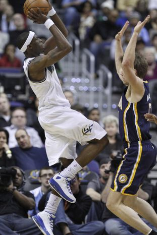 In this photo taken Dec. 29, 2010, Washington Wizards forward Josh Howard (5) shoots while guarded by Indiana Pacers small forward Mike Dunleavy (17) in the first quarter of an NBA basketball game in Washington. (AP Photo/Jacquelyn Martin)