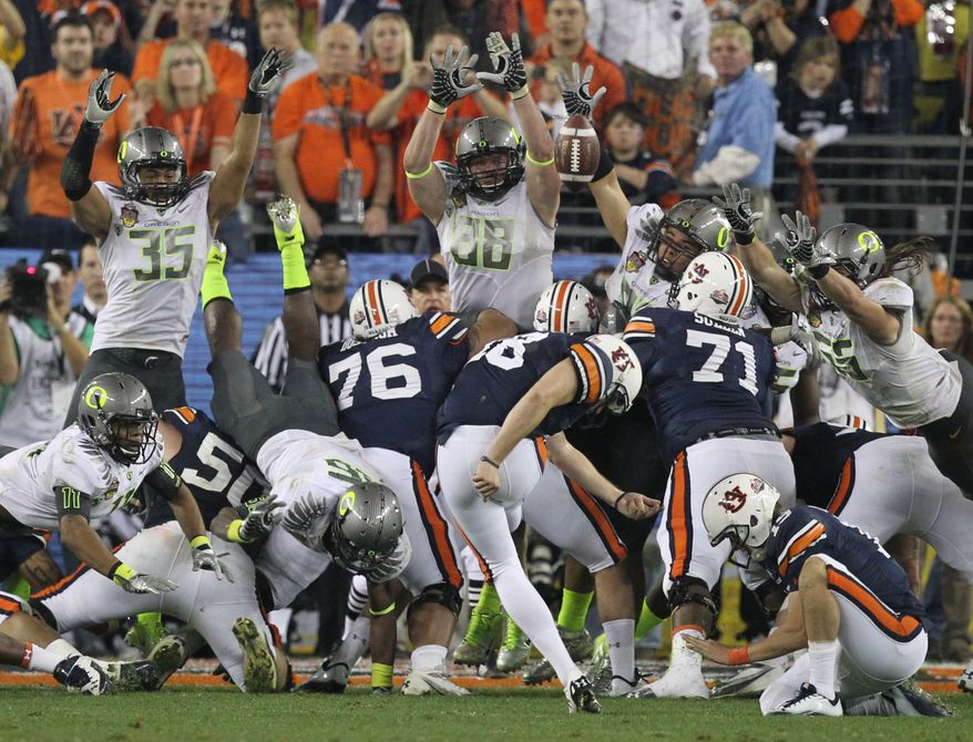 Auburn's Wes Byrum (18) kicks the game-winning field goal late in the second half of the BCS National Championship NCAA college football game against Oregon Monday, Jan. 10, 2011, in Glendale, Ariz. Auburn won 22-19. (AP Photo/Chris Carlson)