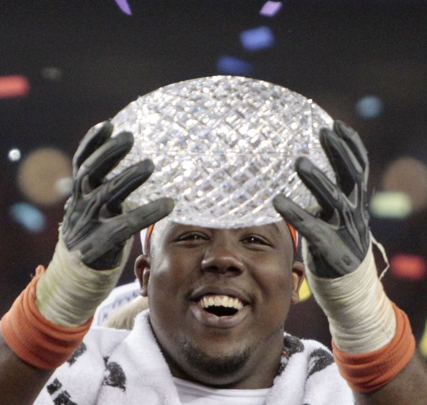 Auburn's Nick Fairley celebrates with the Coaches' Trophy after beating Oregon 22-19 in he BCS National Championship NCAA college football game Monday, Jan. 10, 2011, in Glendale, Ariz. (AP Photo/Matt York)