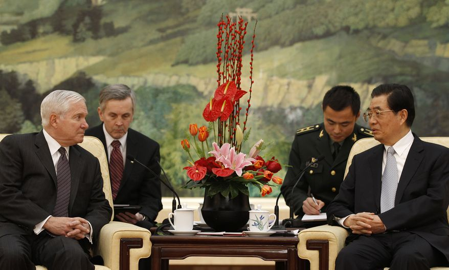 U.S. Secretary of Defense Robert M. Gates (left) meets with Chinese President Hu Jintao at the Great Hall of the People in Beijing on Tuesday, Jan. 11, 2011. (AP Photo/Larry Downing, Pool)