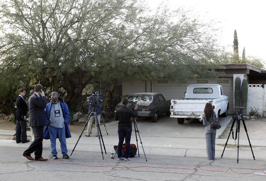 Media stakes out the home of Jared Loughner in Tucson, Ariz., Monday, Jan. 10, 2011. Mr. Loughner is accused of trying to assassinate Rep. Gabrielle Giffords at an event in Tucson on Saturday. (AP Photo/Ross D. Franklin)