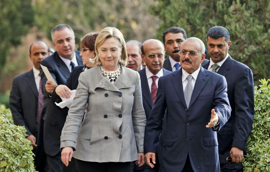 Yemeni President Ali Abdullah Saleh, right, walks with Secretary of State Hillary Rodham Clinton, as she arrives at the Presidential Palace in Sanaa, Yemen, Tuesday, Jan. 11, 2011. (AP Photo/Hani Mohammed)