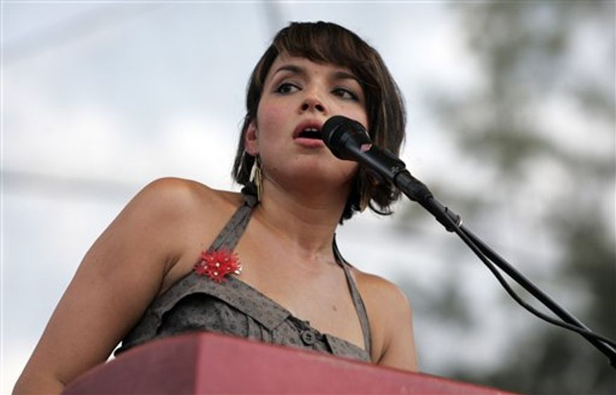 FILE - In this June 12, 2010 file photo, Norah Jones performs at the Bonnaroo Music and Arts Festival in Manchester, Tenn.  (AP Photo/Jeff Christensen, file)