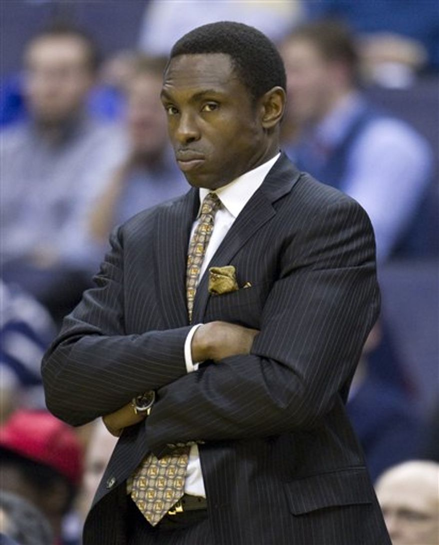New Jersey Nets head coach Avery Johnson looks on during the second half of an NBA basketball game against the Washington Wizards on Friday, Jan. 7, 2011, in Washington.  The Wizards defeated the Nets 97-77.  (AP Photo/Evan Vucci)