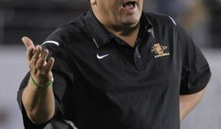 San Diego State coach Brady Hoke tries to communicate during the first half of the Poinsettia Bowl college football game against Navy in San Diego, Thursday, Dec. 23, 2010. (AP Photo/Denis Poroy)