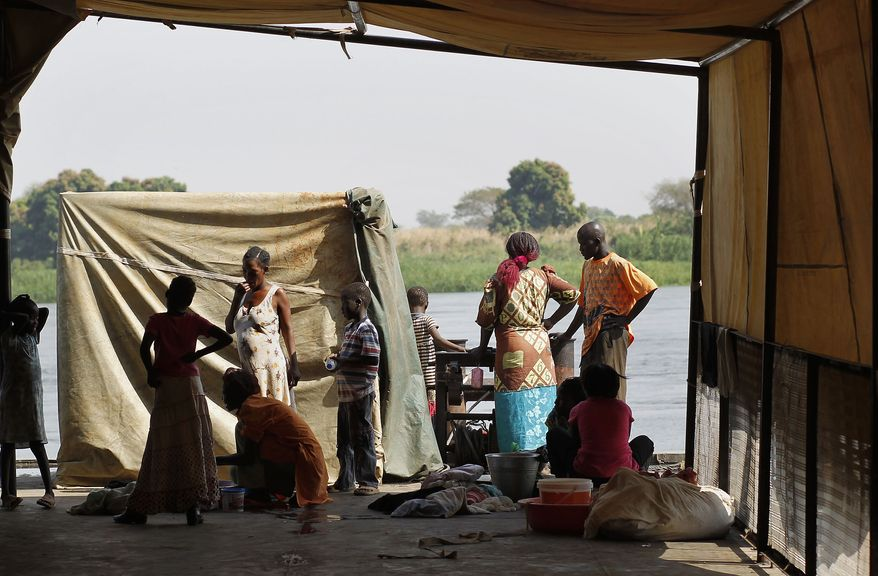 South Sudanese arrive in the Southern Sudan capital of Juba by Nile River barge on Tuesday, Jan. 11, 2011. (AP Photo/Jerome Delay)