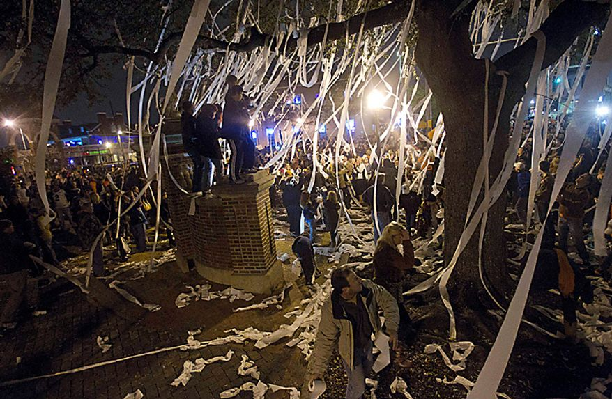 Thousands of Auburn fans gather to roll Toomer's Corner in Auburn, Ala., on Monday, Jan. 10, 2011, following Auburn's 22-19 Auburn win over Oregon in the BCS championship NCAA college football game. (AP Photo/Dave Martin)