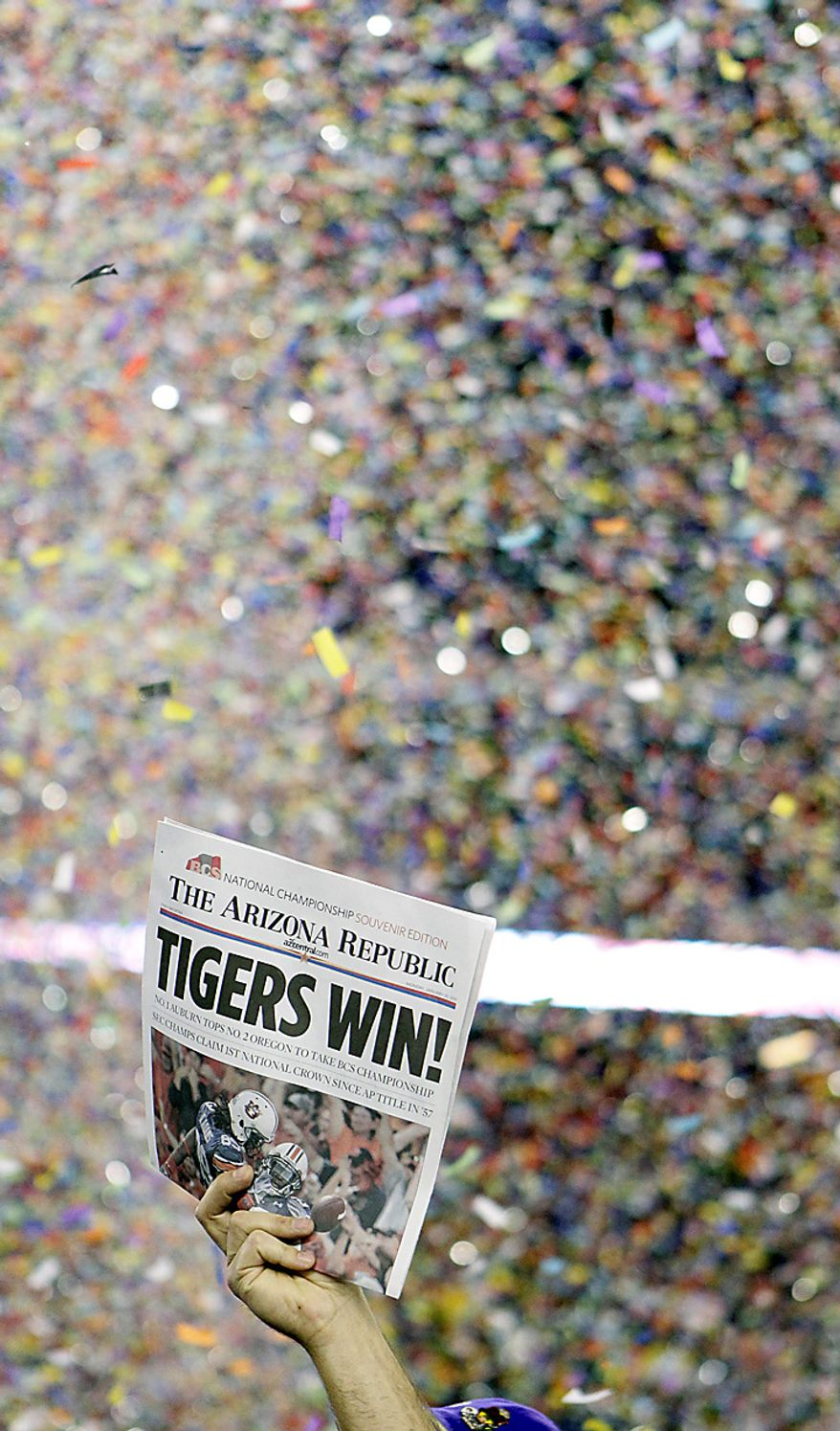 A newspaper announces Auburn's win over Oregon, 22-19, in the BCS national championship NCAA college football game on Monday, Jan. 10, 2011, in Glendale, Ariz. (AP Photo/Matt York)