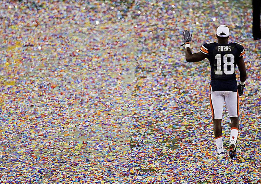 Auburn's Kodi Burns celebrates after the BCS national championship NCAA college football game against Oregon on Monday, Jan. 10, 2011, in Glendale, Ariz. Auburn won, 22-19. (AP Photo/Charlie Riedel)