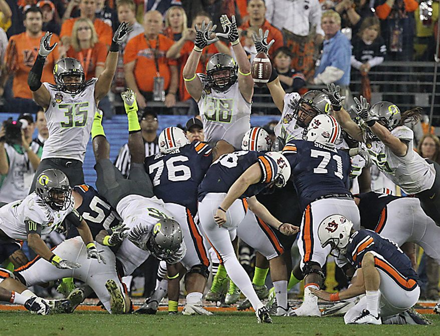 Auburn's Wes Byrum (18) kicks the game-winning field goal late in the second half of the BCS national championship NCAA college football game against Oregon on Monday, Jan. 10, 2011, in Glendale, Ariz. Auburn won, 22-19. (AP Photo/Chris Carlson)