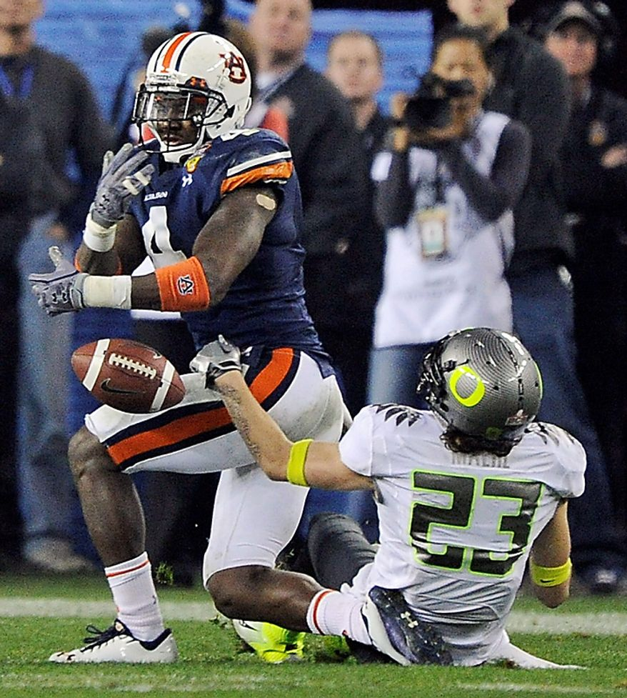 Auburn's Zac Etheridge (4) breaks up a pass intended for Oregon's Jeff Maehl during the second half of the BCS national championship NCAA college football game on Monday, Jan. 10, 2011, in Glendale, Ariz. (AP Photo/Mark J. Terrill)