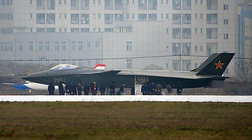 ** FILE ** In this Wednesday, Jan. 5, 2011, photo, people surround a Chinese J-20 stealth plane before its runway test in Chengdu in southwest China. State media are reporting on the appearance online of photos that appear to show a prototype Chinese stealth fighter undergoing testing. (AP Photo/Kyodo News)