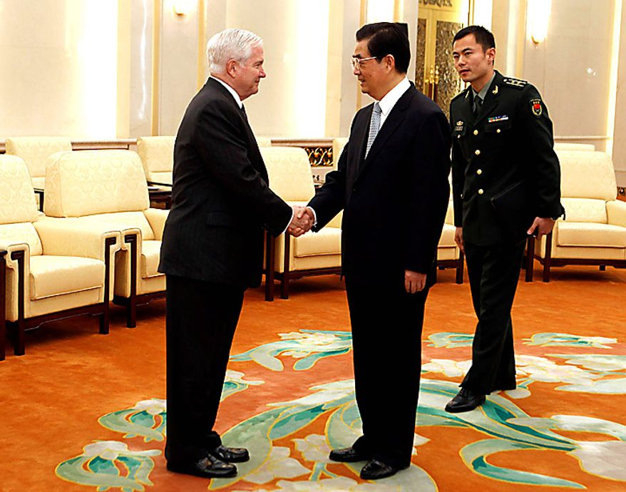 U.S. Secretary of Defense Robert Gates, left, shakes hands with Chinese President Hu Jintao before a meeting at the Great Hall of the People in Beijing on Tuesday, Jan. 11, 2011. (AP Photo/Larry Downing, Pool)