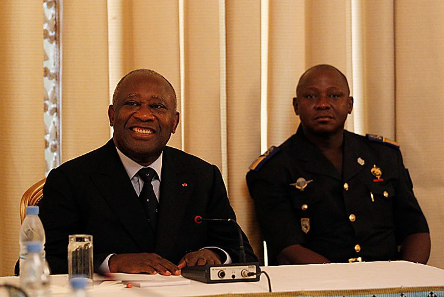 Ivory Coast president Laurent Gbagbo, left, leads a meeting with a group of four Ivorians and three foreign nationals, unseen, invited to investigate purported human rights abuses, at the presidential palace in Abidjan, Ivory Coast, Tuesday, Jan. 11, 2011. Security forces loyal to Mr. Gbagbo, who refuses to cede power, on Tuesday fired volleys of gunshots, leaving at least four people dead after they cordoned off a large section of a neighborhood known to be his rival's stronghold.(AP Photo/Rebecca Blackwell)