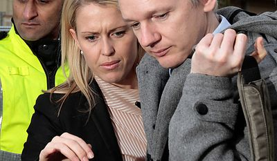 WikiLeaks founder Julian Assange, right, leaves Belmarsh Magistrate's court in London, with lawyer  Jennifer Robinson, center, after his extradition hearing, Tuesday, Jan. 11, 2011.  Mr. Assange was in court Tuesday for a procedural hearing which lasted for only about 10 minutes, as part of his fight to avoid extradition to Sweden on sex crimes allegations. (AP Photo/Lefteris Pitarakis)