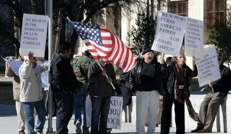 Cuban-Americans rally Monday in support of Luis Posada Carriles at the federal courthouse in El Paso, Texas. Mr. Posada is on trial for perjury, obstruction and naturalization fraud for allegedly lying about his role in a string of 1997 bombings in Havana. (Associated Press)