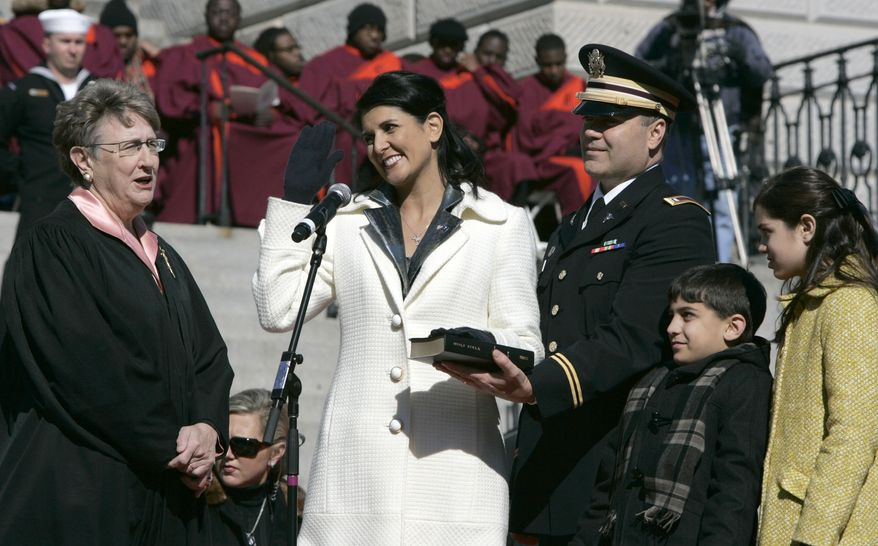 Nikki Haley takes the oath as governor of South Carolina Wednesday, Jan. 12, 2011, at the Statehouse in Columbia, S.C. Chief Justice Jean Toal , left, administers the oath of office as Mrs. Haley's husband Michael and children Rena and Nalin join her at the podium. (AP Photo/Mary Ann Chastain)