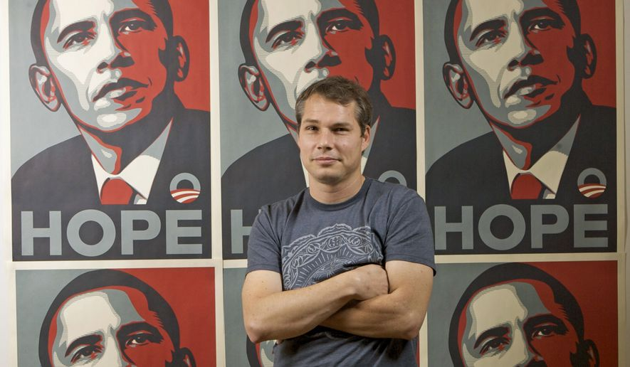 Los Angeles street artist Shepard Fairey poses for a picture with his Barack Obama Hope artwork in the Echo Park area of Los Angeles on Jan. 12, 2009. The Associated Press and Mr. Fairey announced Wednesday, Jan. 12, 2011, that they have agreed to settle their copyright infringement claims against each other and will work together again in projects that use the news agency's pictures. (AP Photo/Damian Dovarganes, File)