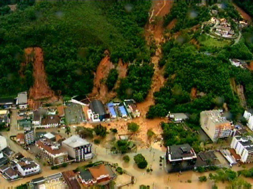 A frame grab from video shows an aerial view of a mudslide in Teresopolis, Brazil, on Wednesday, Jan. 12, 2011. Torrential rain tore through Rio de Janeiro state's mountains, killing at least 140 people in 24 hours, the state's emergency rescue office said. (AP Photo/TV Globo, Agencia O Globo)