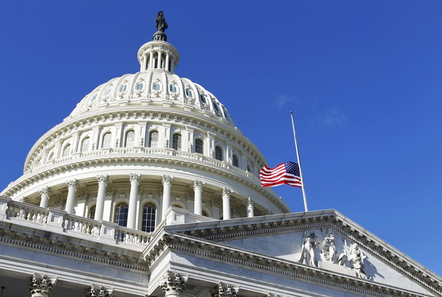 The American flag flies at half-mast on the U.S. Capitol in Washington Sunday, Jan. 9, 2011, to honor the slain aide, Gabe Zimmerman, of Rep. Gabrielle Giffords. Thirty-year-old Zimmerman was among six killed Saturday in a Tucson, Ariz., shooting rampage that left the Democratic congresswoman among 13 wounded. (AP Photo/Manuel Balce Ceneta)