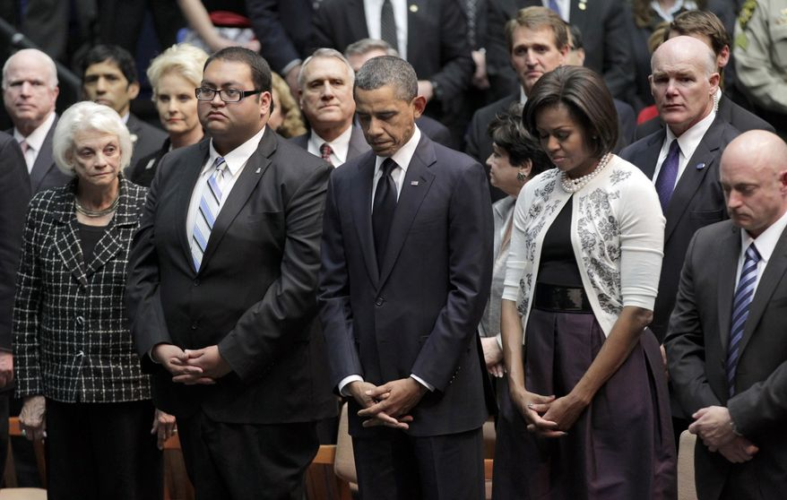 President Barack Obama and first lady Michelle Obama attend memorial service for the victims of Saturday's shootings, at McKale Center on the University of Arizona campus Wednesday, Jan. 12, 2011, in Tucson, Ariz. Second from left is Daniel Hernandez, a University of Arizona political science student who helped Rep. Gabrielle Giffords when she was shot and a right is Mark Kelly, husband of Giffords. (AP Photo/J. Scott Applewhite)