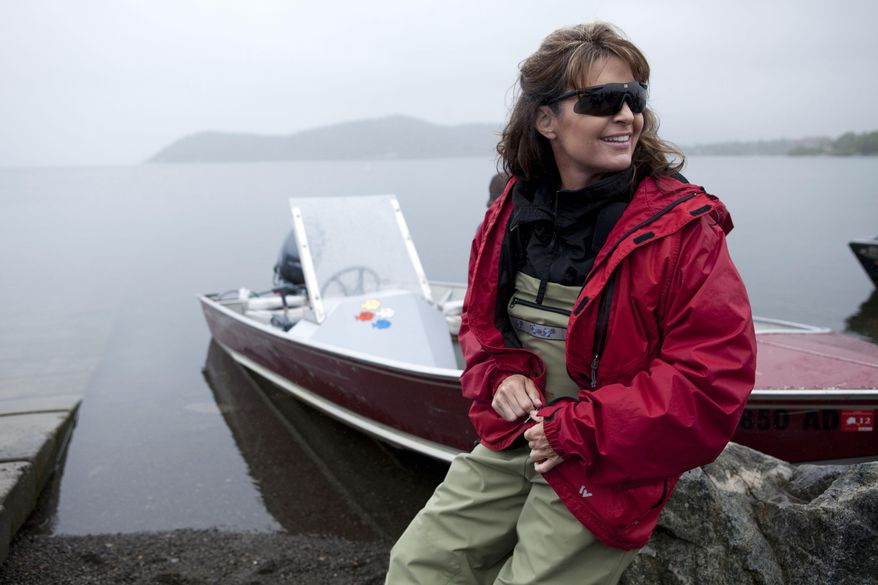 """** FILE ** In this July 2, 2010, photo provided by Discovery Communications, former Alaska Gov. Sarah Palin sits next husband Todd's boat in Dillingham, Alaska, as part of a documentary for the TLC channel called """"Sarah Palin's Alaska."""" (AP Photo/Discovery Communications, Gilles Mingasson, File)"""