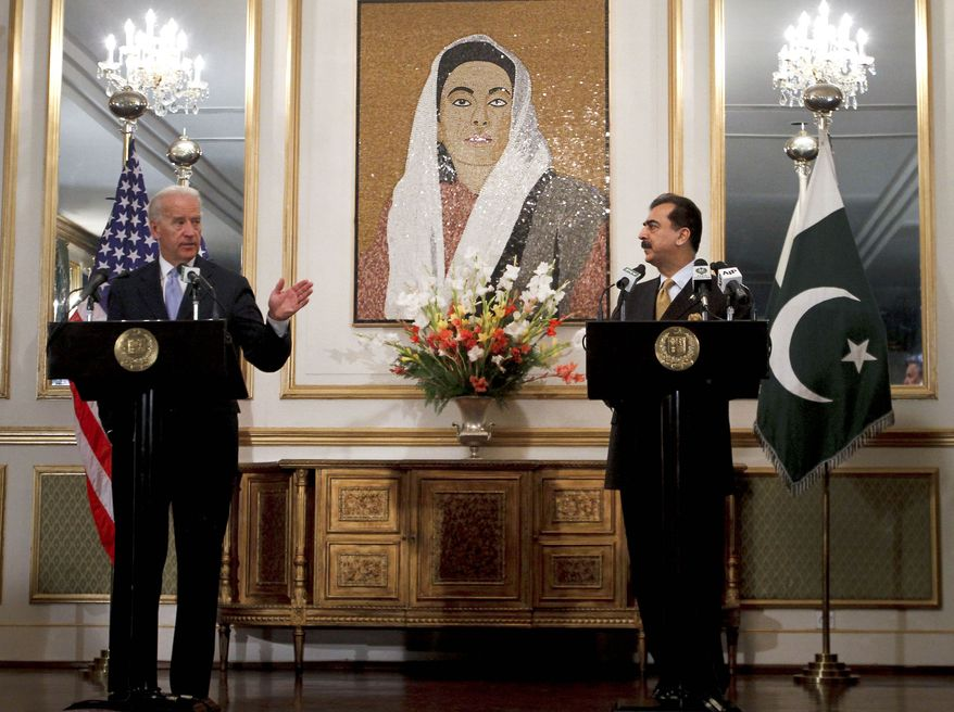 Vice President Joseph R. Biden Jr., left, at a joint press conference with Pakistani Prime Minister Yusuf Raza Gilani at the prime minister's residence in Islamabad, Pakistan, on Wednesday, Jan. 12, 2011. (AP Photo/Anjum Naveed)