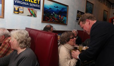 Jean Snidow of Hardy, Va., congratulates Republican Bill Stanley as he arrives at the Cancun Mexican Restaurant & Grill in Hardy, Va., to celebrate with his constituents on Tuesday, Jan. 11, 2011. Stanley defeated Democrat Hank Davis on Tuesday night and will represent the 19th District in the Virginia Senate. (AP Photo/The Roanoke Times, Stephanie Klein-Davis)