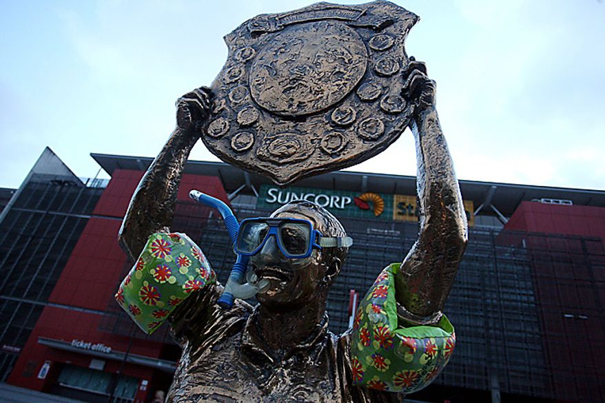 The statue of Queensland's famous former Rugby League star Wally Lewis is fitted out with water wings, scuba mask and snorkel is seen outside the Suncorp Stadium in Brisbane Australia, Wednesday Jan. 12, 2011, The stadium was flooded Wednesday as the rising Brisbane River hit the inner-city.  (AP Photo/Brad Marsellos)