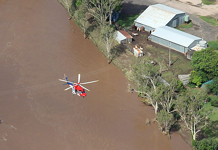 A rescue helicopter flies over a flooded area in South East Queensland, Wednesday, Jan. 12, 2011. Deadly floodwaters flowed onto the streets in Australia's northeastern state of Queensland since drenching rains that began in November sent swollen rivers spilling over their banks, inundating an area larger than France and Germany combined. (AP Photo)