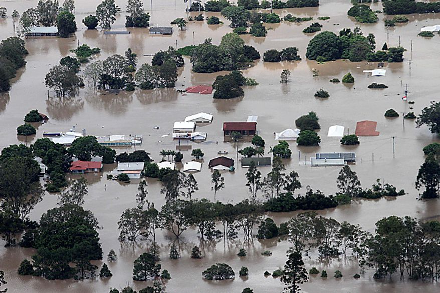 An entire suburb is submerged outside Ipswich, west of Brisbane, Australia, Wednesday, Jan. 12, 2011. Emergency sirens blared across Australia's third-largest city Wednesday as floodwaters that have torn a deadly path across the northeast poured into an empty downtown, swamping neighborhoods in what may be Brisbane's worst flooding in 100 years. (AP Photo)