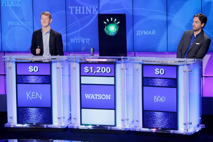 """Jeopardy!"" champions Ken Jennings (left) and Brad Rutter look on as an IBM computer called ""Watson"" beats them to the buzzer to answer a question during a practice round of the long-running TV game show in Yorktown Heights, N.Y., on Thursday. (Associated Press)"