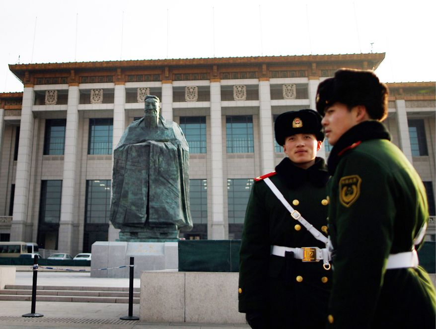 Chinese paramilitary policemen stand guard near Tiananmen Square in Beijing, China's capital. (Associated Press)