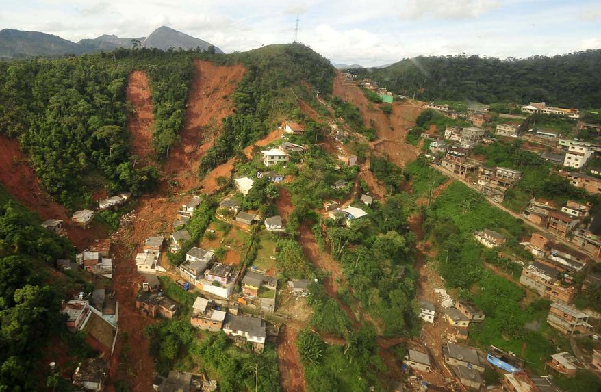 An aerial view shows the mudslide in Teresopolis, Brazil, that killed 152 people on Wednesday, Jan. 12, 2011. (AP Photo/Marino Azevedo, Government of Rio de Janeiro state)