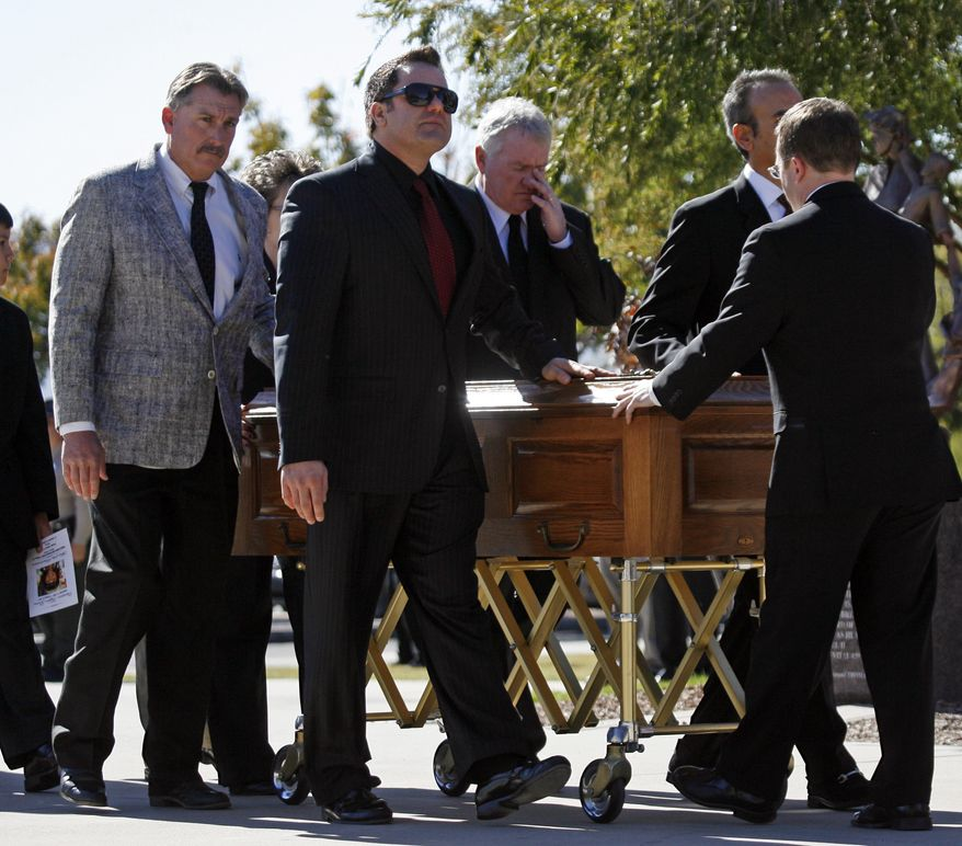 Pall bearers bring escort the casket of 9-year-old Christina Green at the St. Elizabeth Ann Seton Church, before her funeral Thursday, Jan. 13, 2011, in Tucson, Ariz. Christina was the youngest victim of Saturday's shooting in Tucson. (AP Photo/Mamta Popat, Pool)