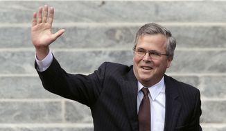 Former Florida Gov. Jeb Bush waves as he is introduced to the crowd during inauguration ceremonies for Florida Gov. Rick Scott on Tuesday, Jan. 4, 2011, outside the Old Capitol in Tallahassee, Fla. (AP Photo/Chris O'Meara)