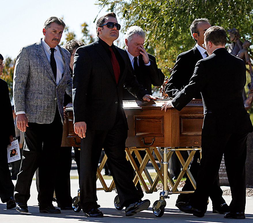 Pall bearers bring escort the casket of 9-year-old Christina Green at the St. Elizabeth Ann Seton Church, before her funeral Thursday, Jan. 13, 2011, in Tucson, Ariz. Green was the youngest victim of Saturday's shooting in Tucson. (AP Photo/Mamta Popat, Pool)