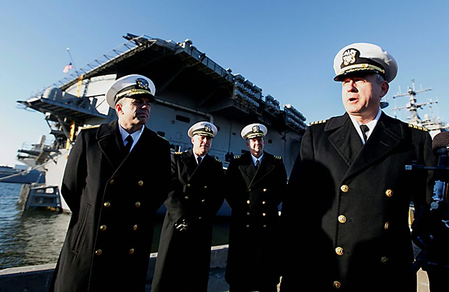 Commander of the USS Enterprise, Capt. Dee L. Mewbourne, right, speaks to the press as the nuclear powered aircraft carrier prepares to deploy to support forces in Afghanistan at Naval Station Norfolk in Norfolk, Va., Thursday, Jan. 13, 2011. The USS Enterprise is deploying without its former commander, Capt. Owen Honors, as Navy brass investigates bawdy, sexually themed videos he showed to thousands of crew members. (AP Photo/Steve Helber)