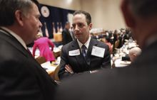 Reince Priebus, of the Wisconsin Republican Party, talks with members during the Republican National Committee Winter Meeting on Friday, Jan. 14, 2011, in Oxon Hill, Md. (AP Photo/Pablo Martinez Monsivais)