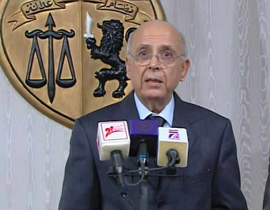 Prime Minister of Tunisia, Mohammed Ghannouchi, appears on state television Friday Jan. 14, 2011, to announce that he is assuming power in Tunisia. The announcement came on Friday after many thousands of protesters mobbed the capital of Tunis to demand the ousting of President Zine El Abidine Ben Ali, and unconfirmed reports said he has already left the country. (AP Photo)