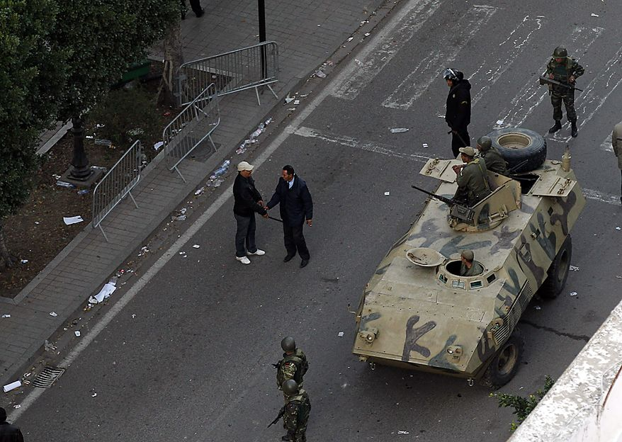 An armored vehicle patrols a street in Tunis during clashes, Friday, Jan. 14, 2011.  Tunisia's president declared a state of emergency and announced that he would fire his government as violent protests escalated Friday, with gunfire echoing in the North African country's usually calm capital and police lobbing tear gas at protesters. (AP Photo/Christophe Ena)