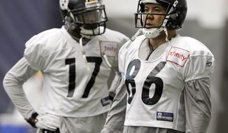 Pittsburgh Steelers receivers Hines Ward (86) and Mike Wallace (17) participate in the NFL team's practice in Pittsburgh, Wednesday , Jan. 12, 2011. The Steelers host the Baltimore Ravens Jan. 15 in a divisional playoff game. (AP Photo/Gene J. Puskar)