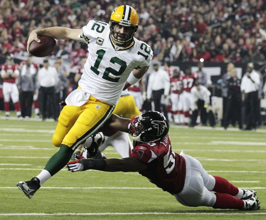Green Bay Packers quarterback Aaron Rodgers (12) scrambles past Atlanta Falcons linebacker Curtis Lofton (50) on a 7-yard touchdown run during the second half of an NFL divisional playoff football game on Saturday, Jan. 15, 2011, in Atlanta. (AP Photo/Dave Martin)