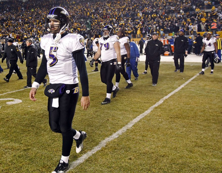 Baltimore Ravens quarterback Joe Flacco (5) walks off the field after losing 31-24 to the Pittsburgh Steelers in an NFL divisional football game in Pittsburgh, Saturday, Jan. 15, 2011. (AP Photo/Keith Srakocic)