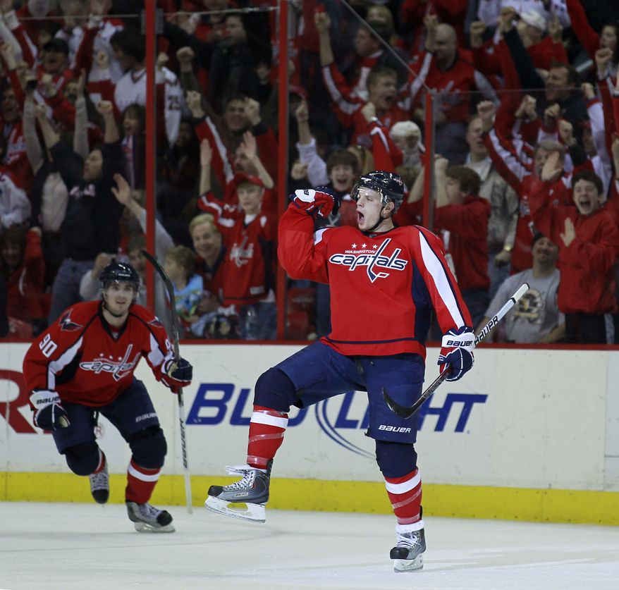 Washington Capitals defenseman John Carlson right, celebrates his goal as center Marcus Johansson (90) skates to him in the third period of an NHL hockey game with the Ottawa Senators in Washington Sunday, Jan. 16, 2011. The Capitals won 3-1. (AP Photo/Alex Brandon)