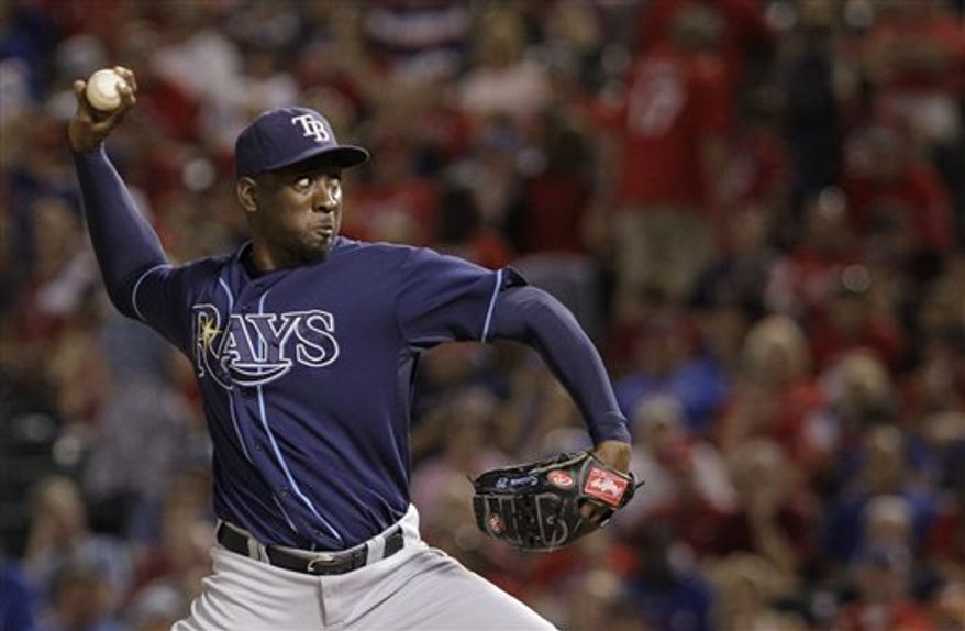 FILE - In this Oct. 9, 2010, file photo, Tampa Bay Rays relief pitcher Rafael Soriano delivers the ball to the Texas Rangers during Game 3 of the American League Division Series baseball game in Arlington, Texas. A person familiar with negotiations tells The Associated Press that the New York Yankees have reached a three-year agreement with Soriano, last years AL saves leader. (AP Photo/Tony Gutierrez, File)